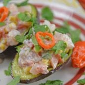 Zesty Shrimp Salad Avocados are an easy, no-cook recipe using shrimp, corn, tomatoes & bell pepper with a zesty yogurt sauce served in avocado halves. #shrimpsalad #avocadorecipes www.savoryexperiments.com
