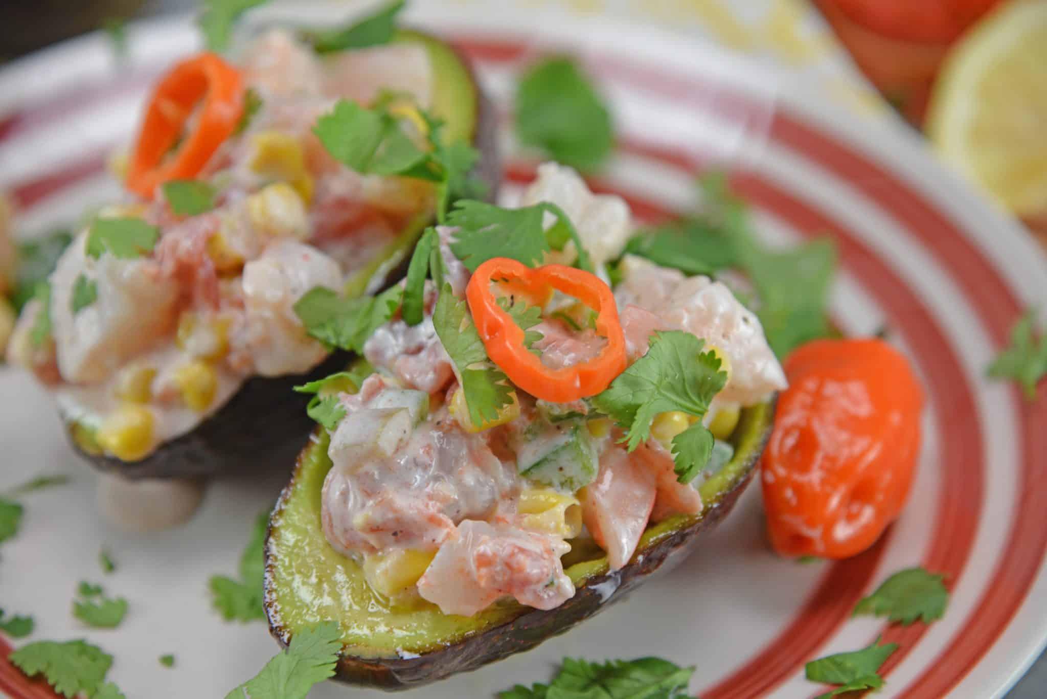 Zesty Shrimp Salad Avocados are an easy, no-cook recipe using shrimp, corn, tomatoes & bell pepper with a zesty yogurt sauce served in avocado halves. #shrimpsalad #avocadorecipes www.savoryexperiments.com