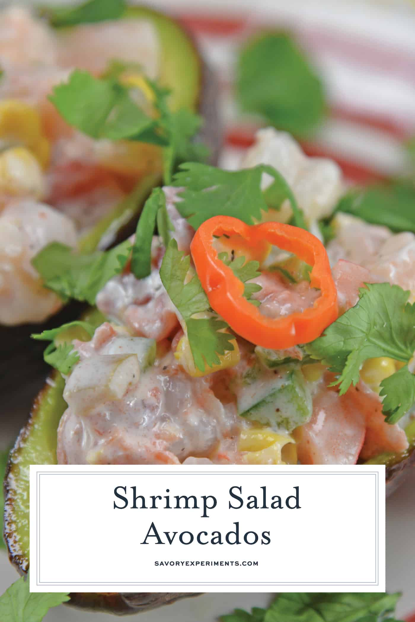Shrimp salad in an avocado halve with habanero slice