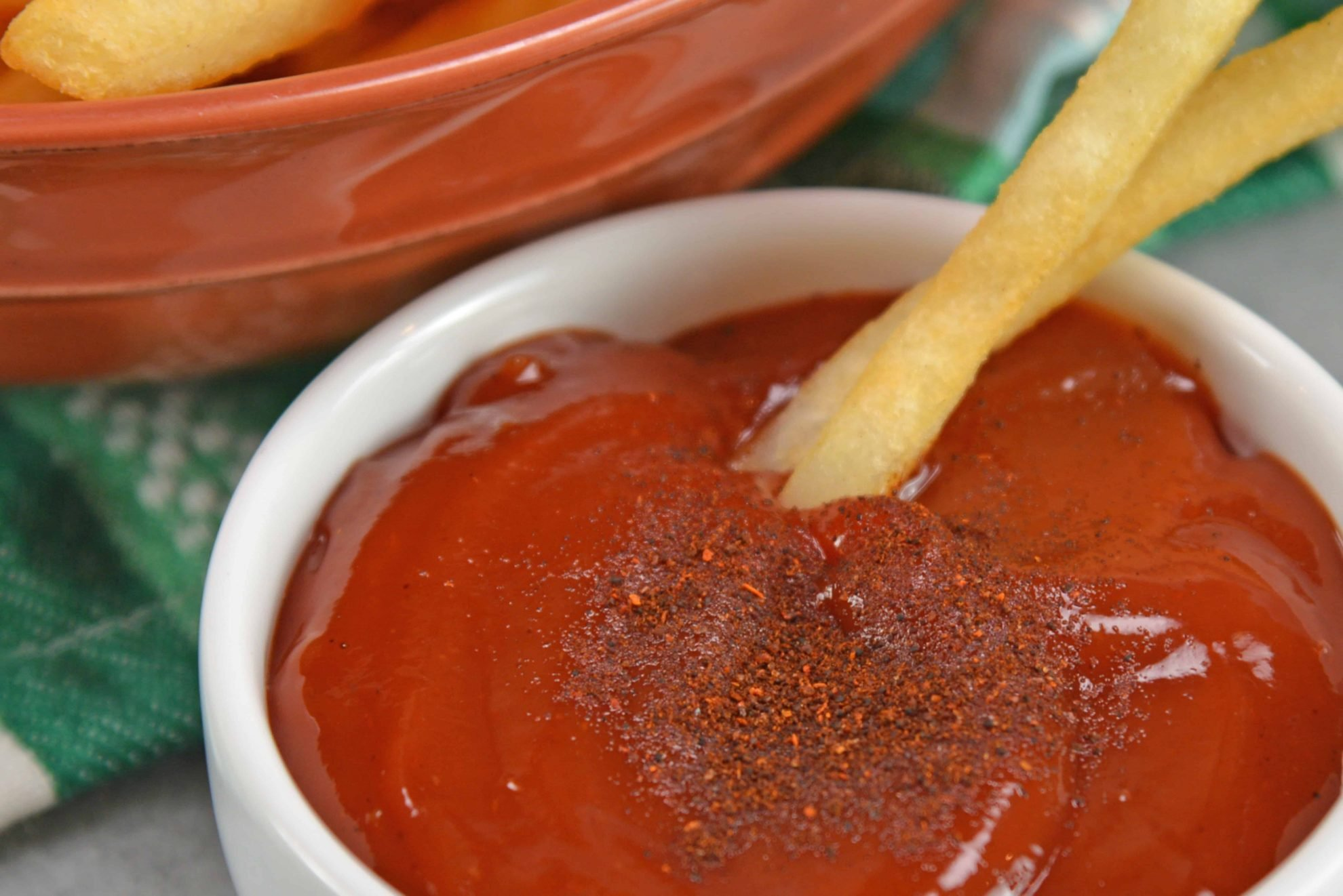 Spicy Ketchup is a sauce that kicks up a classic and favorite. Serve with fries, on a burger or hot dog or anything else that needs some zing! #spicyketchup #hotketchup www.savoryexperiments.com