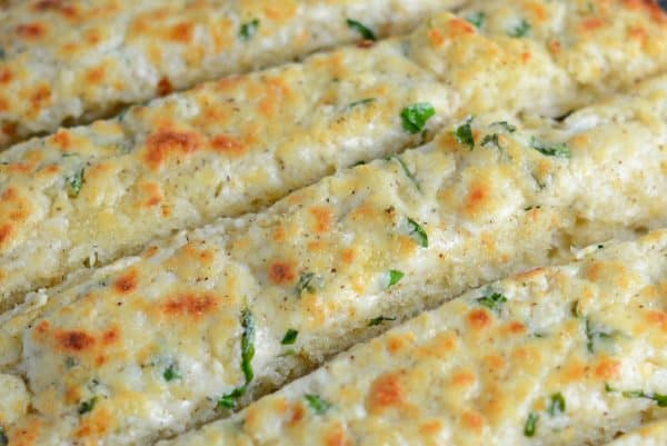 Cheesy Garlic Bread is made with a blend of cheese, cream cheese, garlic and seasonings to make the BEST garlic bread you've ever tasted!