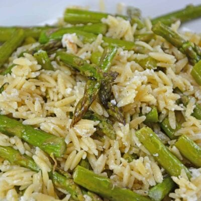 Orzo Salad is a quick side dish recipe that uses quick cooking pasta with creamy goat cheese and roasted asparagus spears.