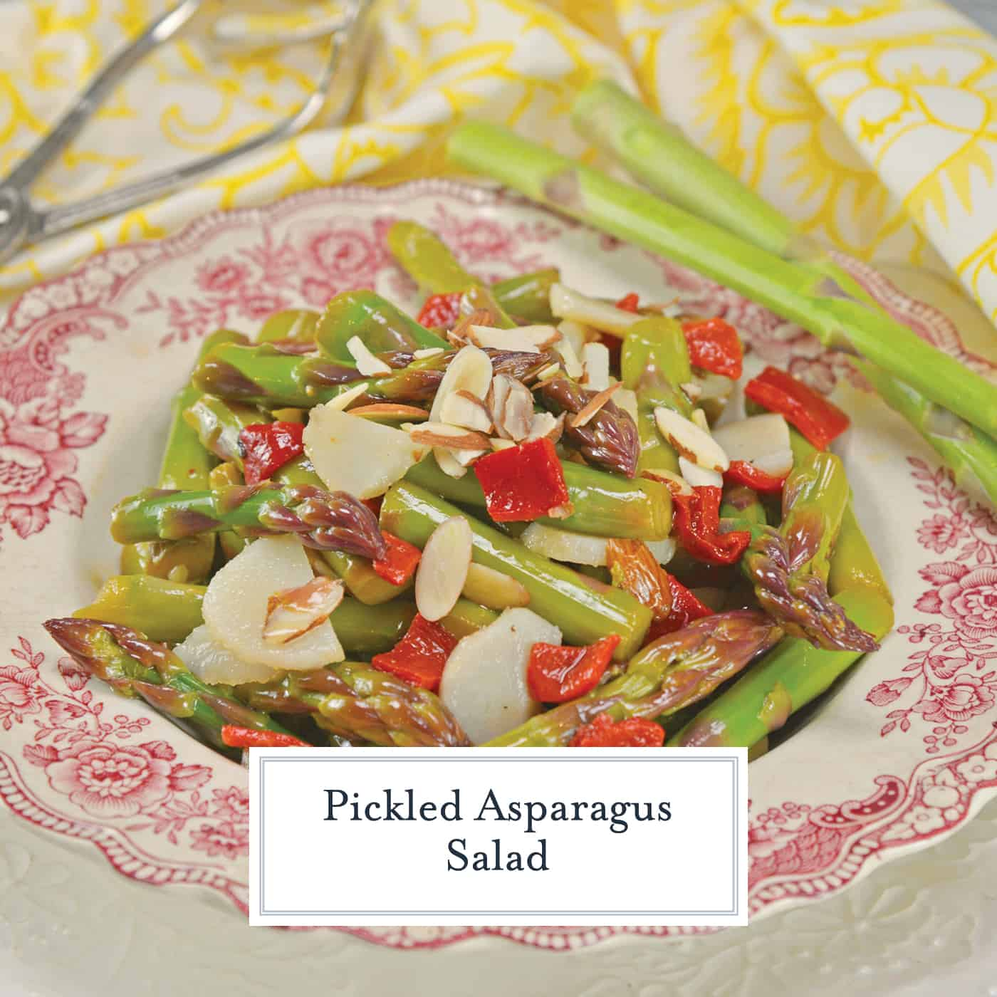Pickled Asparagus Salad is made with blanched asparagus marinated in a vinaigrette and tossed with water chestnuts, roasted red pepper and almonds. #asparagussalad #pickledasparagus www.savoryexperiments.com