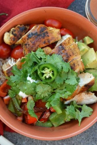 Chipotle Chicken Rice Bowls are a zesty chipotle chicken with fresh produce and sweet dressing. Ready in just 30 minutes and perfect as a meal prep recipe!