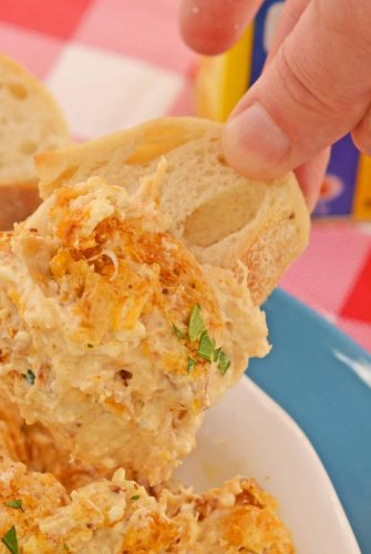 Hot Crab Dip with cream cheese is a is a Maryland classic! Blended with cheese, lump crab and Old Bay, this crab dip served hot is the best party appetizer recipe! #hotcrabdip #partyappetizerrecipes www.savoryexperiments.com
