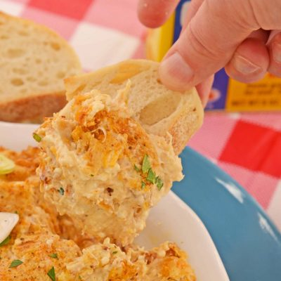 Hot Crab Dip with cream cheese is a is a Maryland classic! Blended with cheese, lump crab and Old Bay, this crab dip served hot is the best party appetizer!