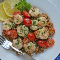 Garlic Butter Shrimp is a quick and easy meal solution that takes only 10 minutes to prepare! Served over wholesome quinoa with garlicky shrimp and tomatoes.