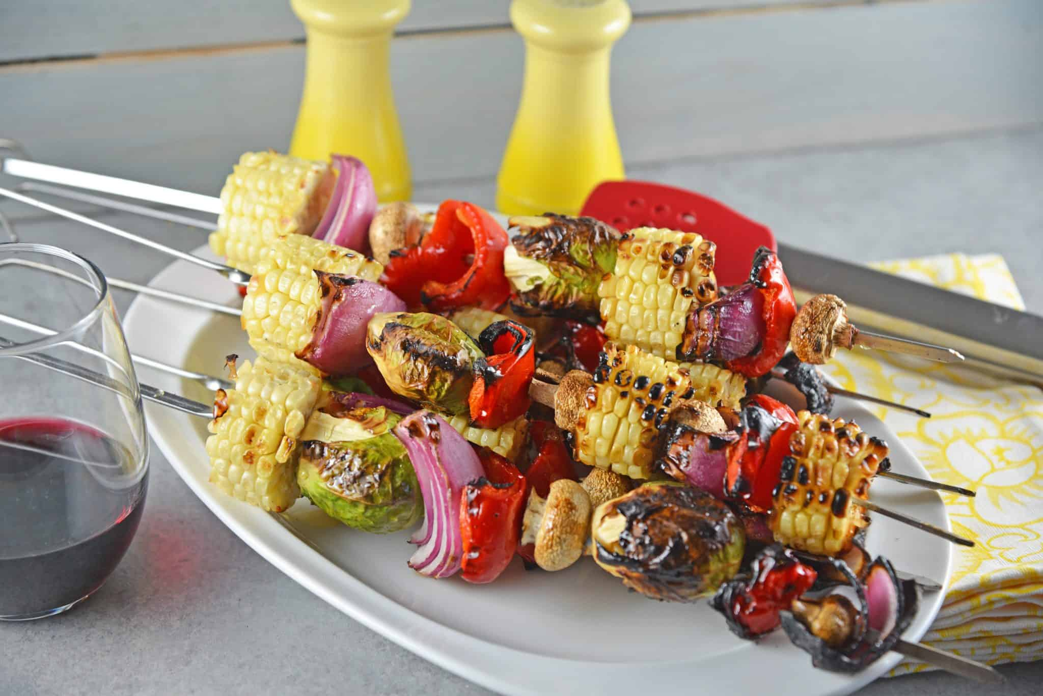 Spicy Honey Vegetable Kabobs are brightly colored skewered grilled vegetables with a sweet and spicy sauce. The perfect side dish for any grilled meal!