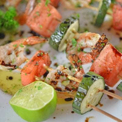 Watermelon Shrimp Kabobs combine grilled shrimp with grilled watermelon with a sweet balsamic reduction and zesty lime. A healthy kabob recipe on the grill.