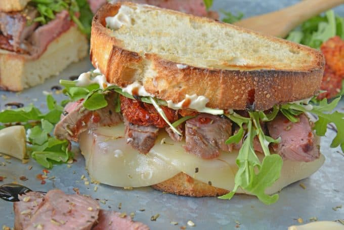 Insane Steak Sandwiches are gourmet sandwiches, seasoned to perfection with zesty Italian herbs and toppings. The best steak sandwich recipe ever! #steaksandwiches #gourmetsandwiches www.savoryexperiments.com