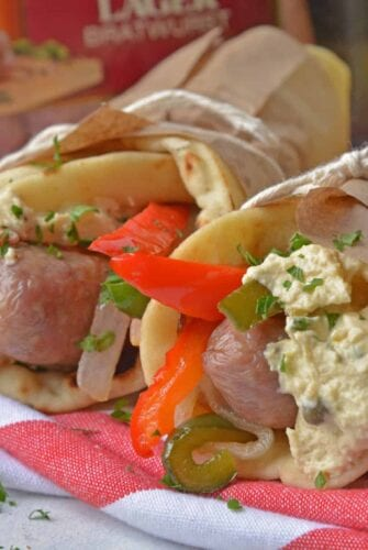 Mediterranean Yuengling Bratwurst use bratwurst injected with Yuengling, bell peppers and onion, garlic hummus and wrap them in naan. www.savoryexperiments.com
