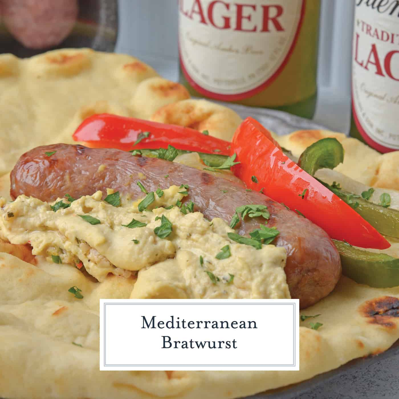 Mediterranean Bratwurst use juicy bratwurst, sautéed bell peppers and onion, garlic hummus and wrapped in tender naan bread. A simple grilled summer meal. #bratwurstsandwich www.savoryexperiments.com