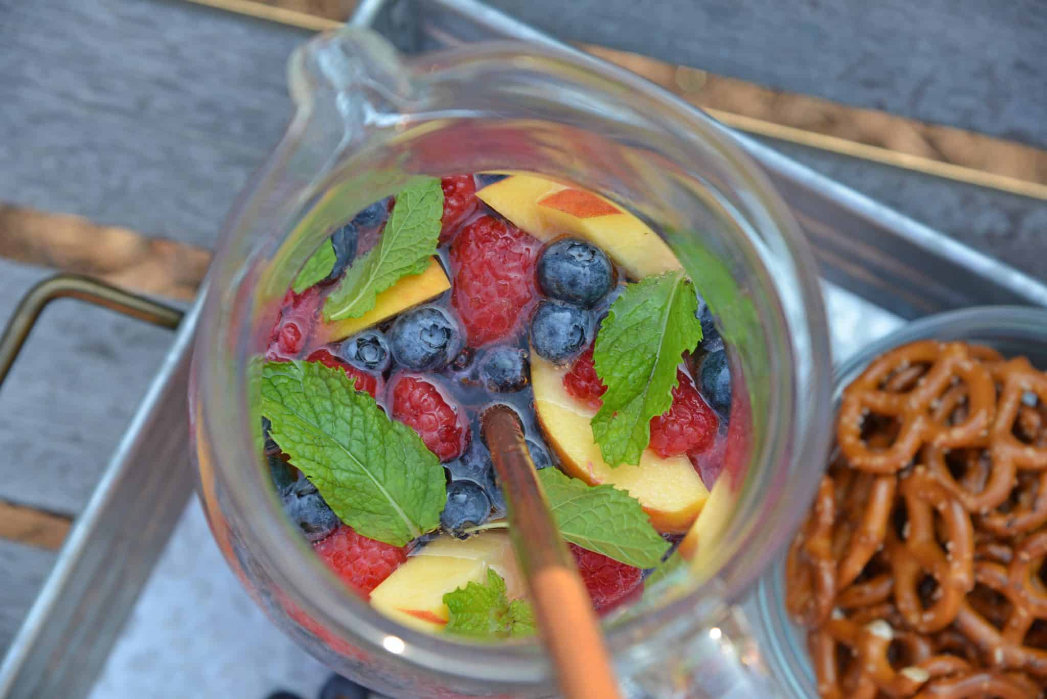 Sparkling Peach Sangria is the perfect summer cocktail recipe for your next party! Make a non-alcoholic and alcoholic version with fresh summer fruits.
