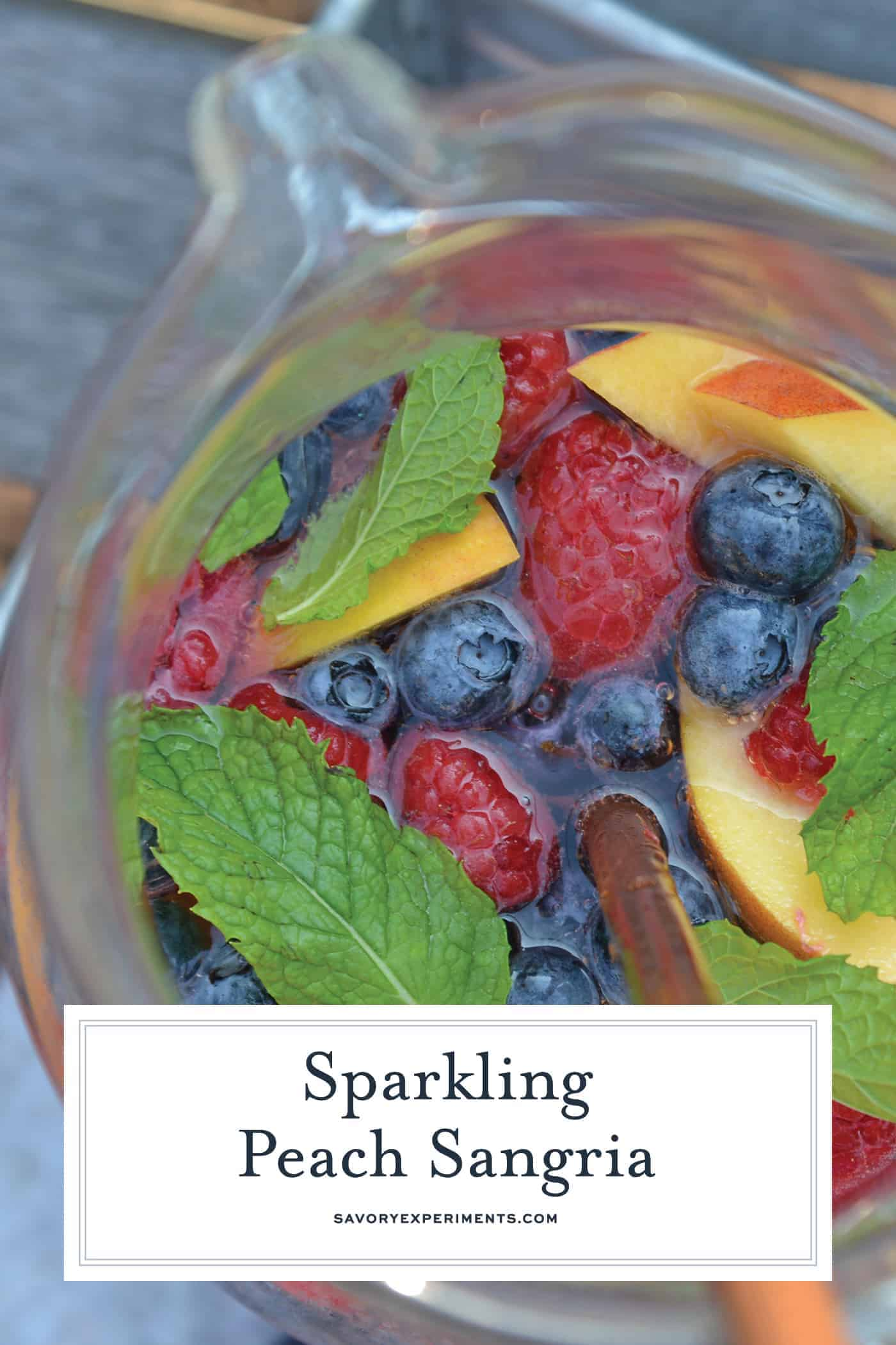 Sparkling white wine sangria in a glass pitcher