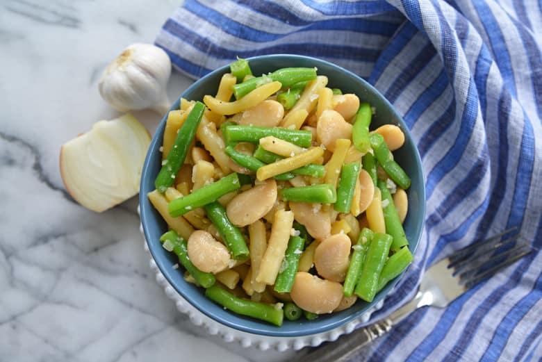 three bean salad in a blue bowl