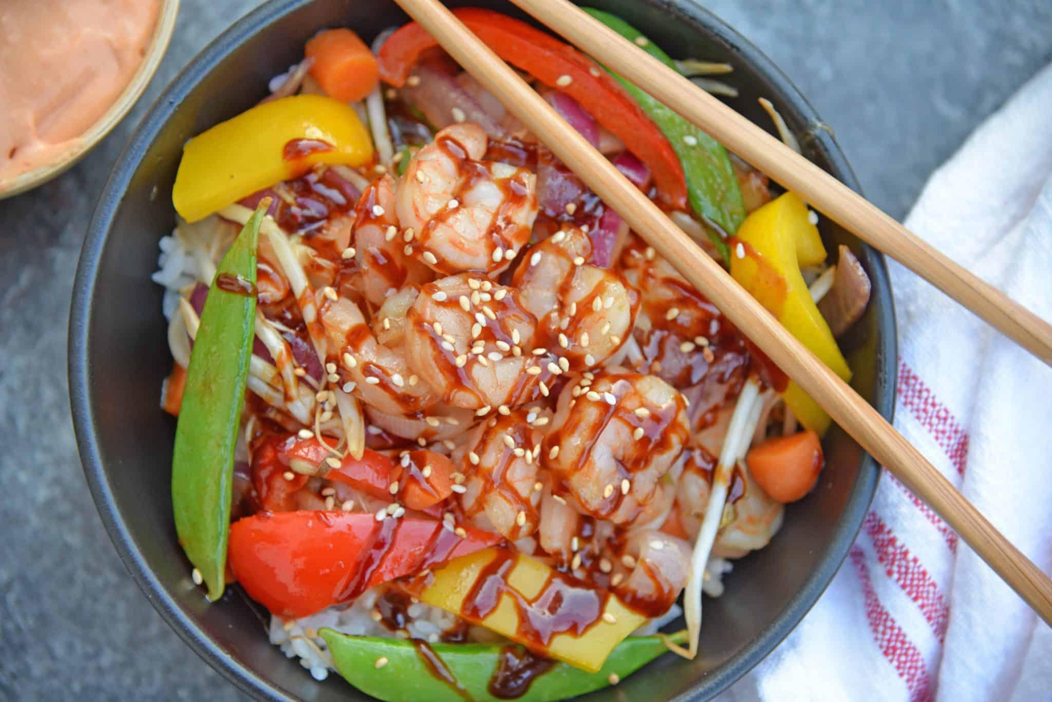 Teriyaki Shrimp Stir Fry in a black bowl