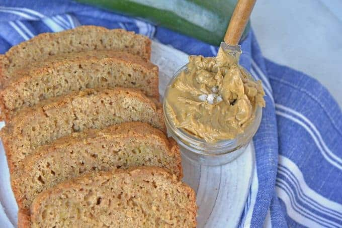 Best Zucchini Bread is the most moist zucchini bread recipe made by a pastry chef. One of the best zucchini recipes ever! Serve with zingy molasses butter. #bestzucchinibread #zucchinirecipes www.savoryexperiments.com
