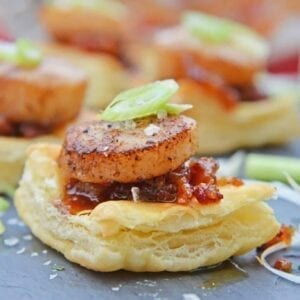 Bacon Jam Scallops are a play on classic bacon wrapped scallops, only using sweet and salty bacon jam with scallions and flaky puff pastry! #puffpastryappetizers#scallopappetizers #baconjam www.savoryexperiments.com