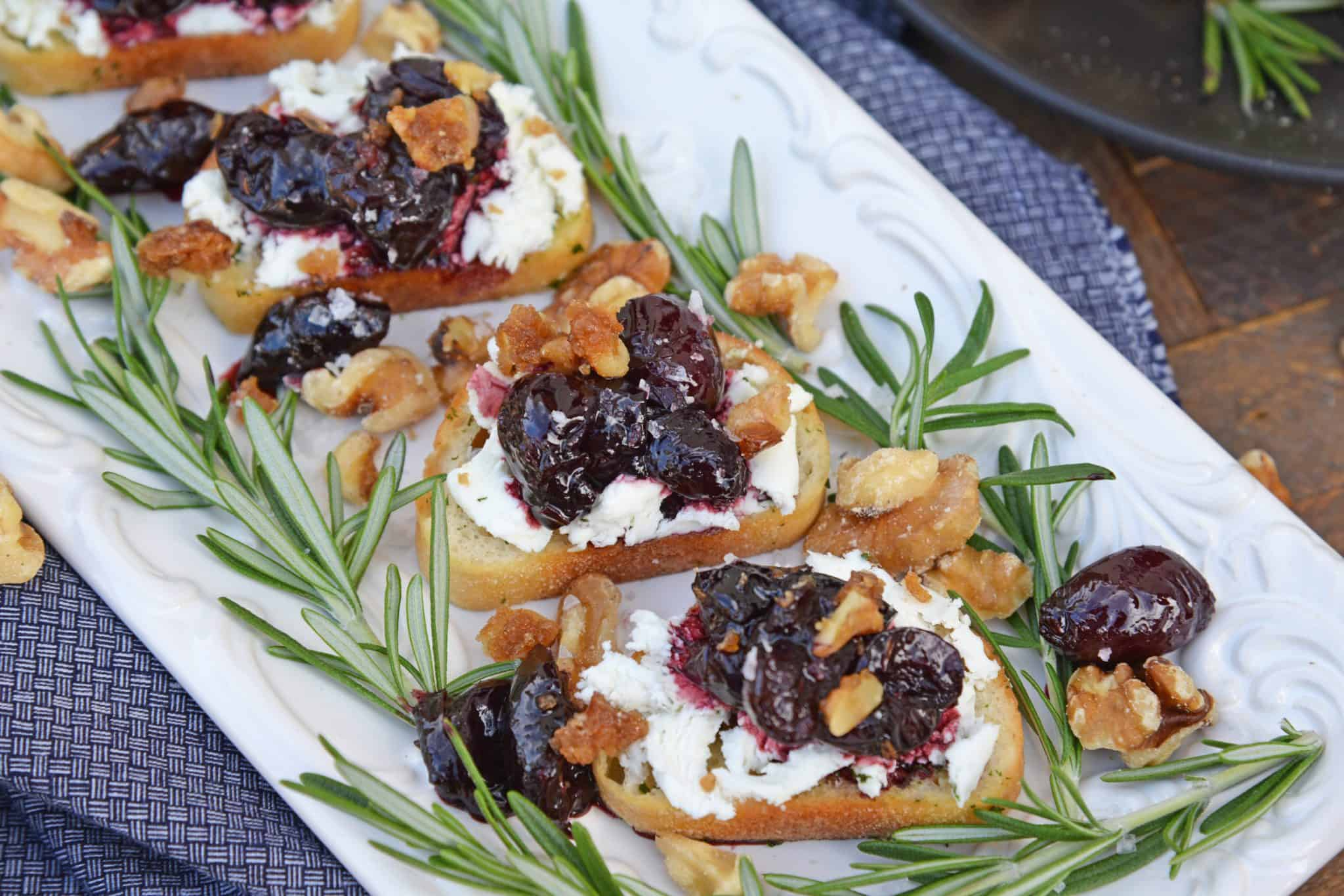 Balsamic Cherry Crostini is an easy appetizer using goat cheese and a tangy cherry balsamic reduction. The perfect holiday appetizer recipe! #crostinirecipes #easyappetizerrecipes www.savoryexperiments.com