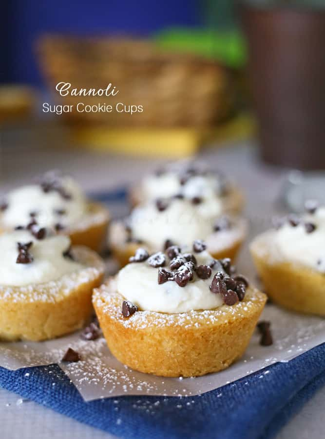 Close up of cannoli sugar cookie cups on a blue napkin