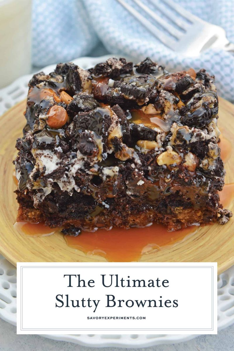caramel covered slutty brownies on a wood plate