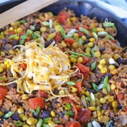 Mexican Beef and Rice Casserole in a skillet with a wooden spoon