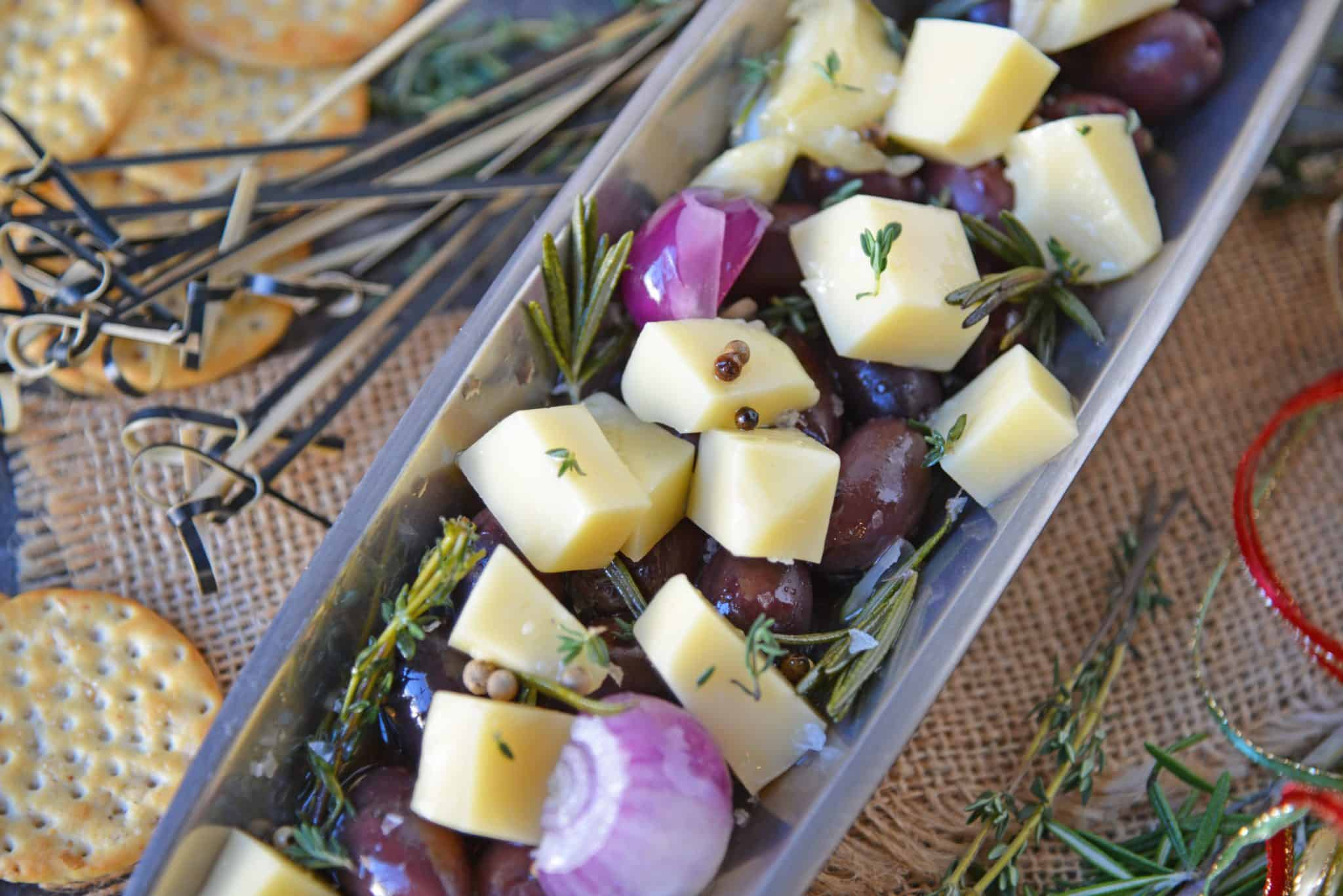 Marinated Cheese is the perfect hostess or homemade holiday gift. Simple and tasty, it also makes an easy party appetizer! #marinatedcheese #easypartyappetizers #homemadegifts www.savoryexperiments.com