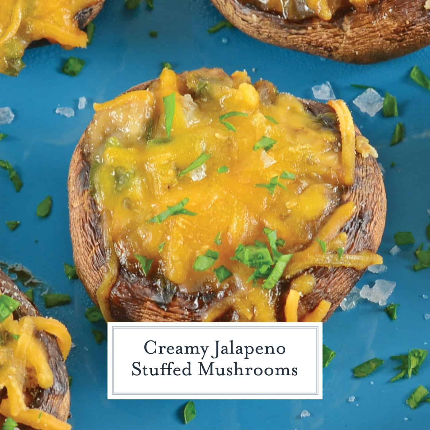 Creamy Jalapeno Stuffed Mushrooms are an easy jalapeno popper make ahead recipe using cream cheese and fresh jalapenos. The perfect party appetizer! #stuffedmushrooms #jalapenopopperrecipes #makeaheadappetizers www.savoryexperiments.com