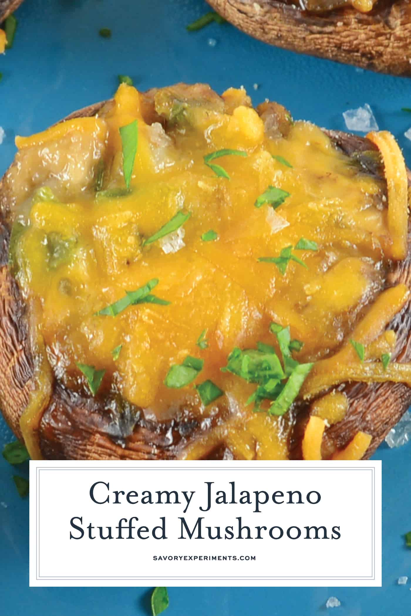 Creamy Jalapeno Stuffed Mushrooms are an easy jalapeno popper make ahead recipe using cream cheese and fresh jalapenos.The perfect party appetizer! #stuffedmushrooms #jalapenopopperrecipes #makeaheadappetizers www.savoryexperiments.com