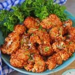 BBQ Cauliflower Bites make a healthy and quick appetizer or side. Make them zesty, tangy or even sweet! #cauliflowerrecipes #bbqcauliflowerbites www.savoryexperiments.com