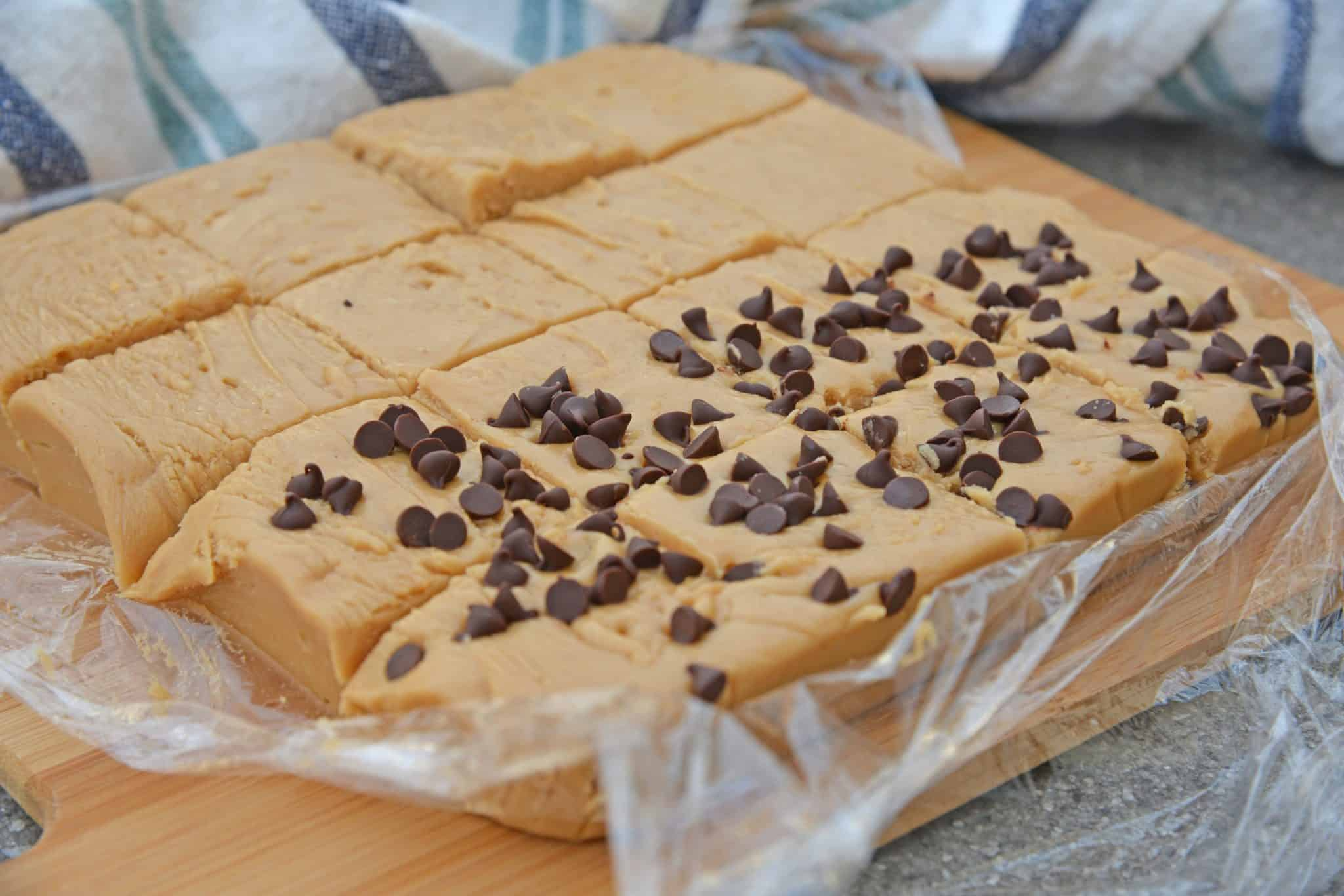 Easy Peanut Butter Fudge is rich, decadent and perfectly creamy. Simple instructions for how to make fudge in just 10 minutes!#peanutbutterfudge #easyfudge #fudge www.savoryexperiments.com