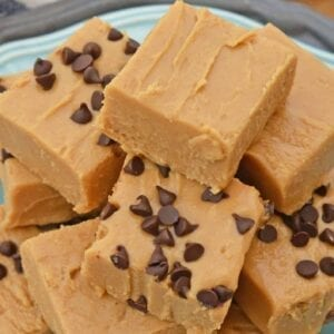 Stack of peanut butter fudge on a blue plate