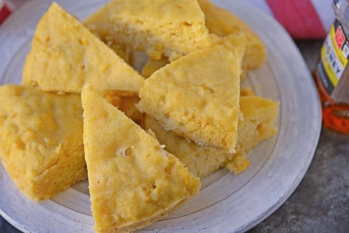 Instant Pot Sweet Cornbread is an easy cornbread recipe made with honey making it both sweet and moist. Made in the Instant Pot, it cooks in half the time!#cornbreadrecipe #instantpotrecipes #sweetcornbread www.savoryexperiments.com