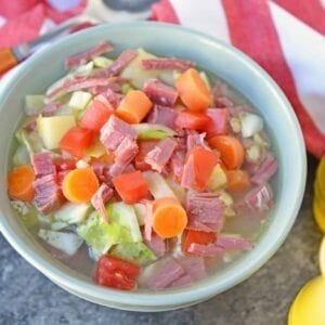 Leftover Corned Beef and Cabbage Soup is the best way to make another full meal from your Irish feast packed with vibrant veggies and seasoning. #cornedbeefsoup #leftovercornedbeefrecipes #easysouprcipes www.savoryexperiments.com