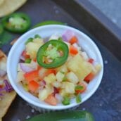 Looking for an easy homemade salsa recipe? With pineapple, jalapenos, peppers and lime juice, you can't go wrong with this Pineapple Salsa recipe! #pineapplesalsa #pineapplesalsarecipe #homemadesalsarecipe www.savoryexperiments.com