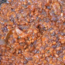 Cowboy Homemade Baked Beans in a skillet with a spoon