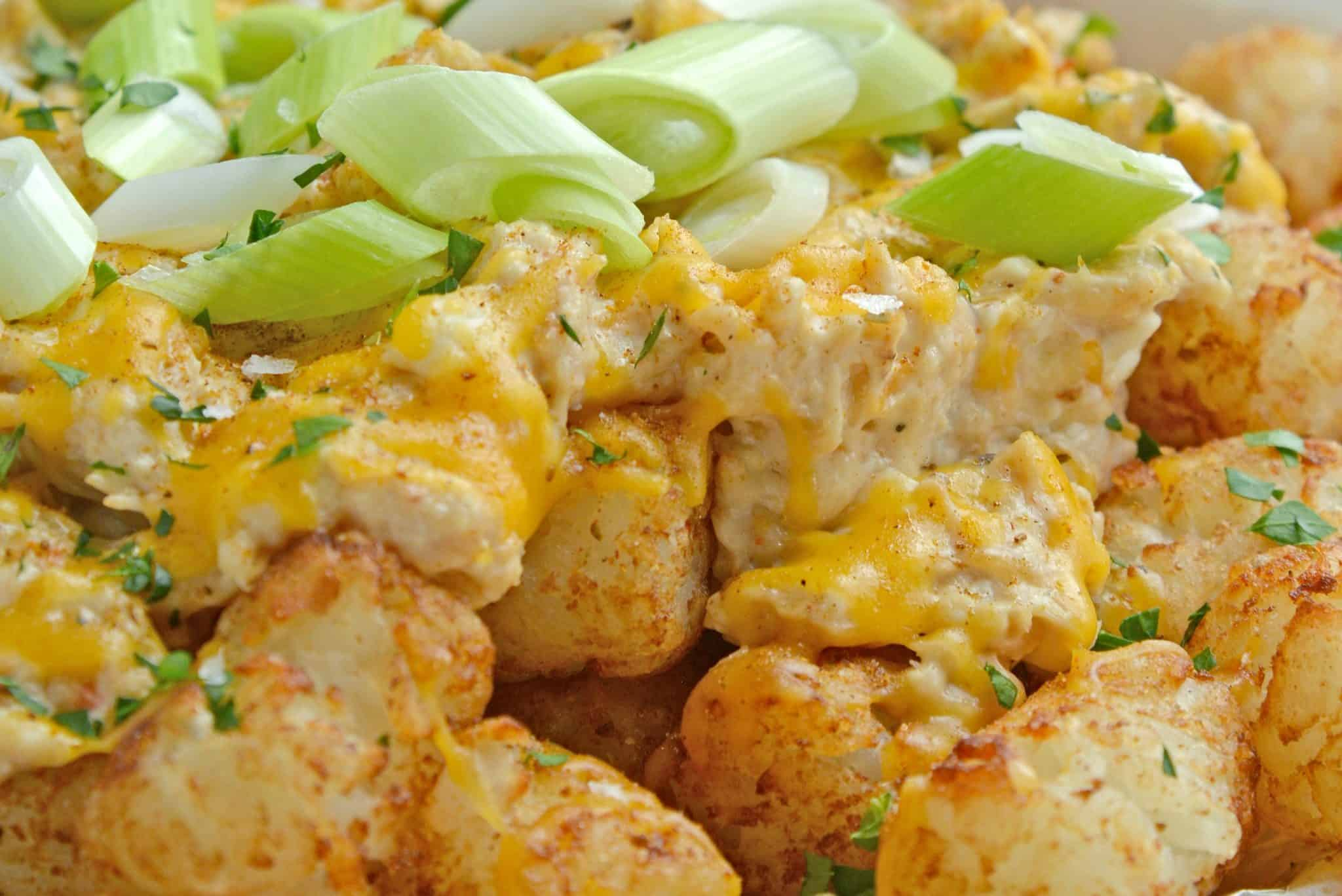 Crabby Totchos are crispy fried tater tots smothered in hot crab dip and topped with melty cheddar cheese. The perfect party appetizer!#tatertots #easyappetizerrecipes www.savoryexperiments.com