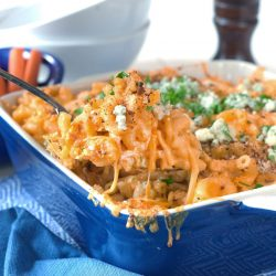 spoon with cheesy mac and cheese