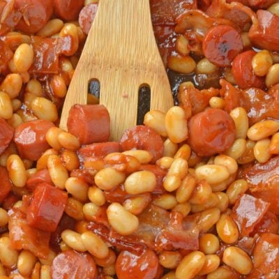 This Franks and Beans recipe, aka Beanie Weenies, is made with real beef hot dogs and less sugar than the canned version. Perfect as a quick and easy lunch or a classic camping food! #franksandbeans #homemadebeanieweenies www.savoryexperiments.com