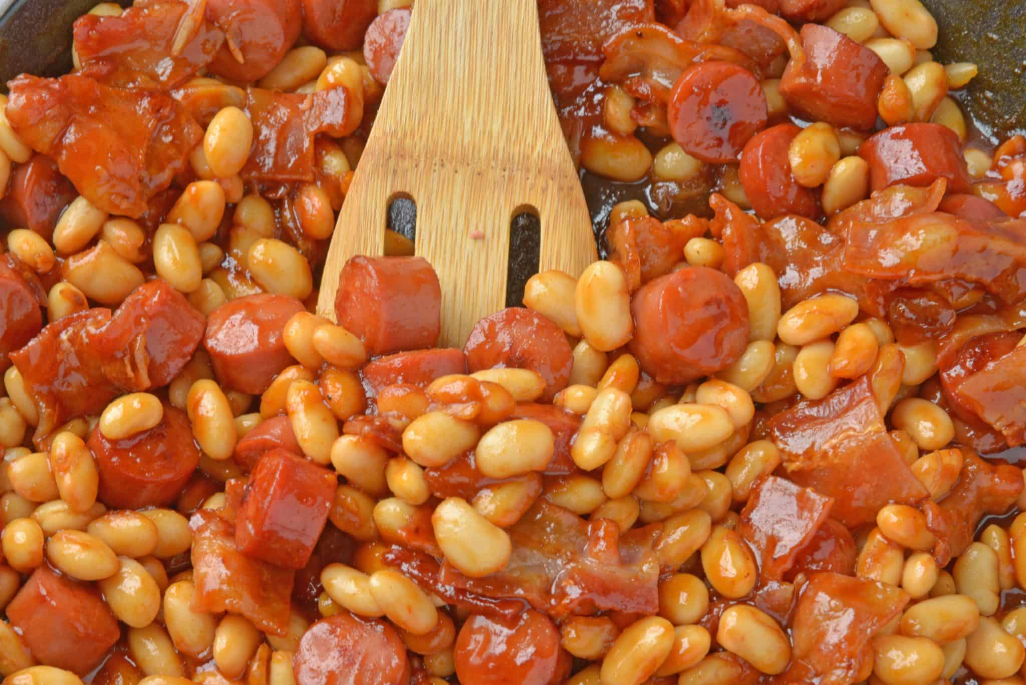 This Franks and Beans recipe is made with real beef hot dogs and less sugar than the canned version. Perfect as a quick and easy lunch or a classic camping food! #franksandbeans #homemadebeanieweenies www.savoryexperiments.com