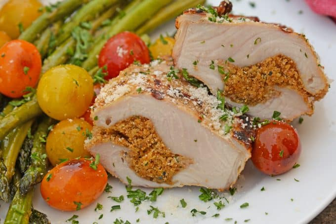 Grilled Stuffed Pork Chops are an easy grilled pork recipe. Herb marinated pork is stuffed with bread crumbs, herbs and Parmesan cheese and grilled to flavorful perfection in just 15 minutes! #grilledporkchops #stuffedporkchops www.savoryexperiments.com