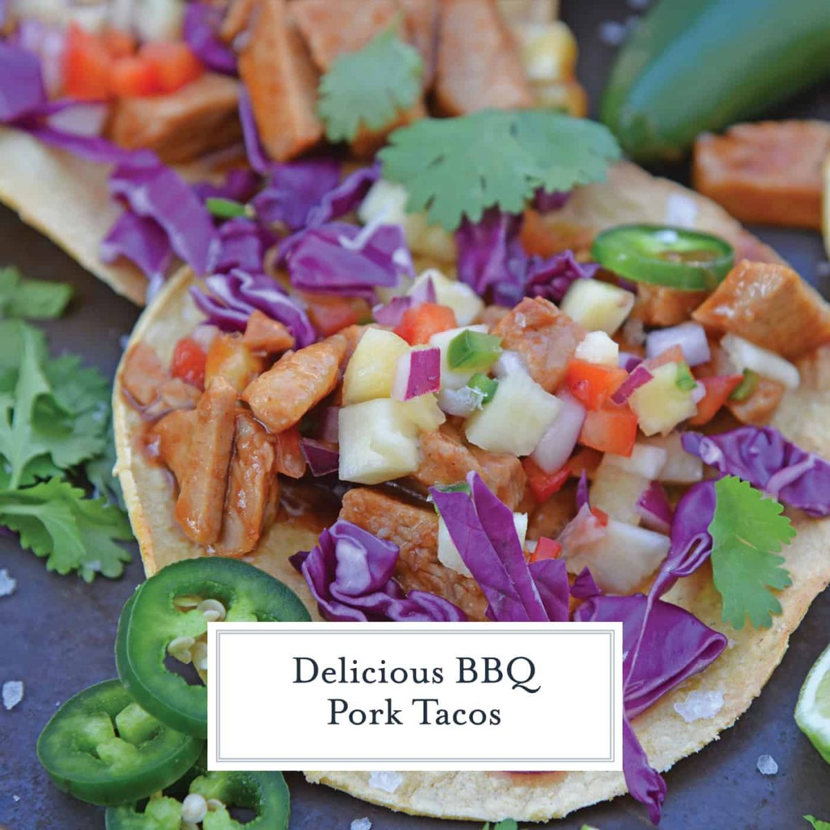 BBQ Pork Tacos are a colorful and easy weeknight dinner. Zesty BBQ sauce paired with sweet and spicy pineapple salsa and crunchy red cabbage. #porktacos #tacotuesday www.savoryexperiments.com