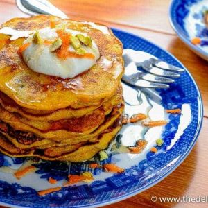 Stack of carrot pancakes on a blue plate