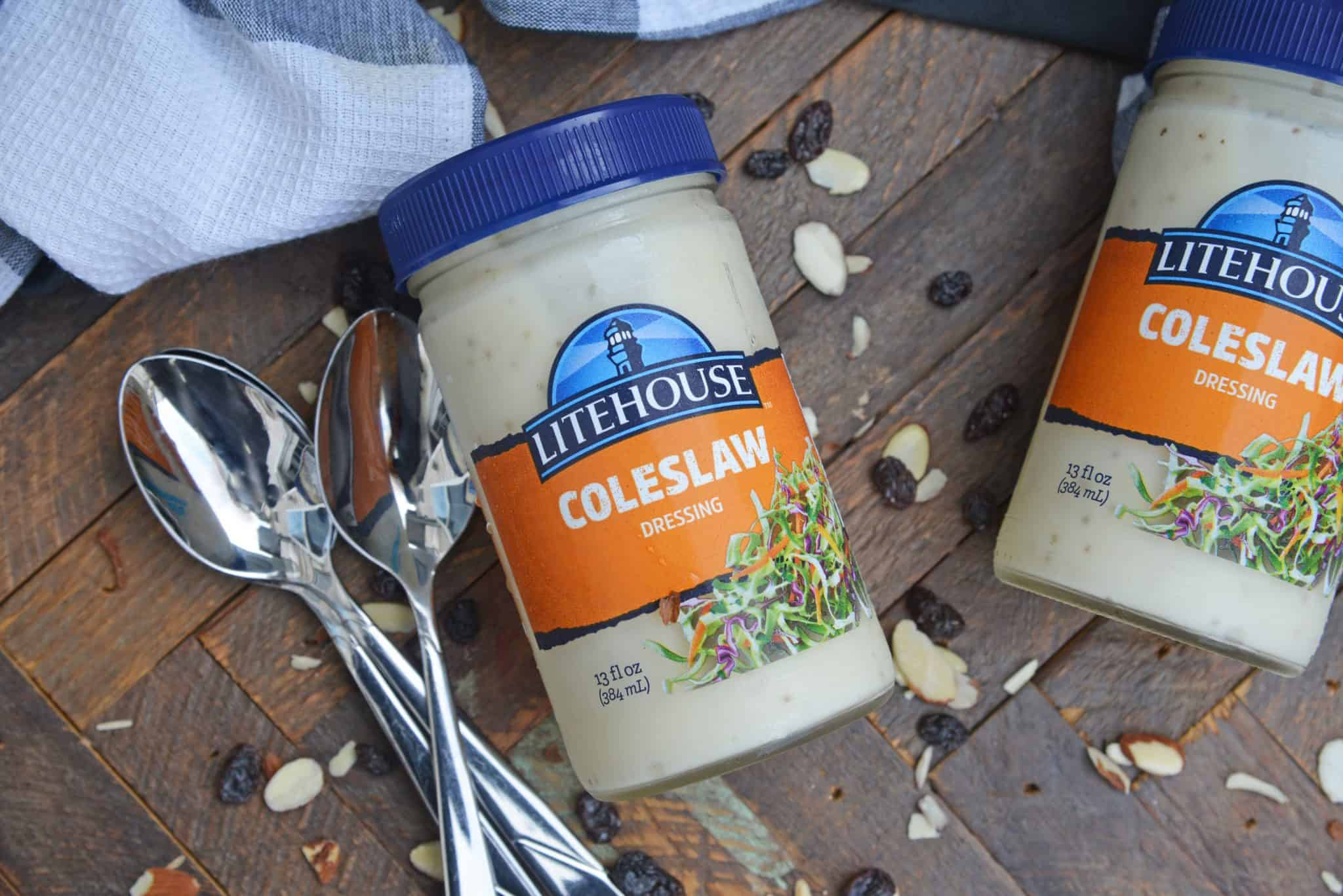 Creamy Coleslaw with almonds and raisins is an easy coleslaw recipe that is mix and serve. Coleslaw dressing, almonds, raisins and crisp cabbage mix are the perfect BBQ dish. #creamycoleslaw @coleslawrecipe www.savoryexperiments.com