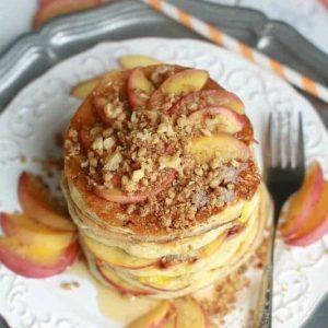 Peach cobbler pancakes on a white plate
