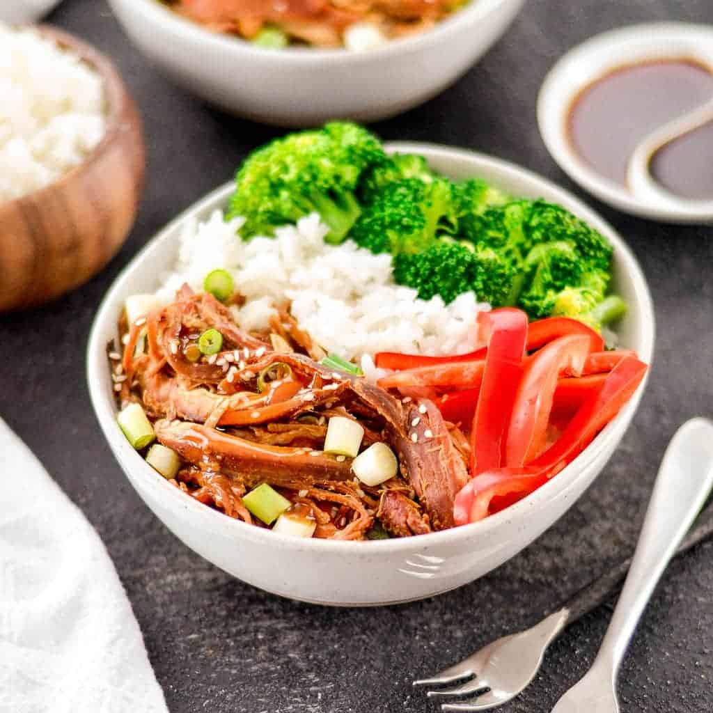 Teriyaki chicken with peppers, rice and broccoli