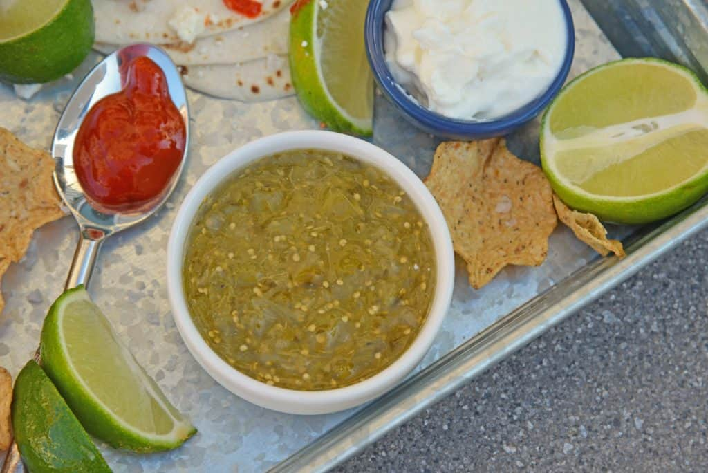 Tomatillo salsa is an easy, versatile homemade salsa that can be added to your favorite Mexican recipes or served as an appetizer with chips. #tomatillosalsa #salsaverde #greensalsa www.savoryexperiments.com