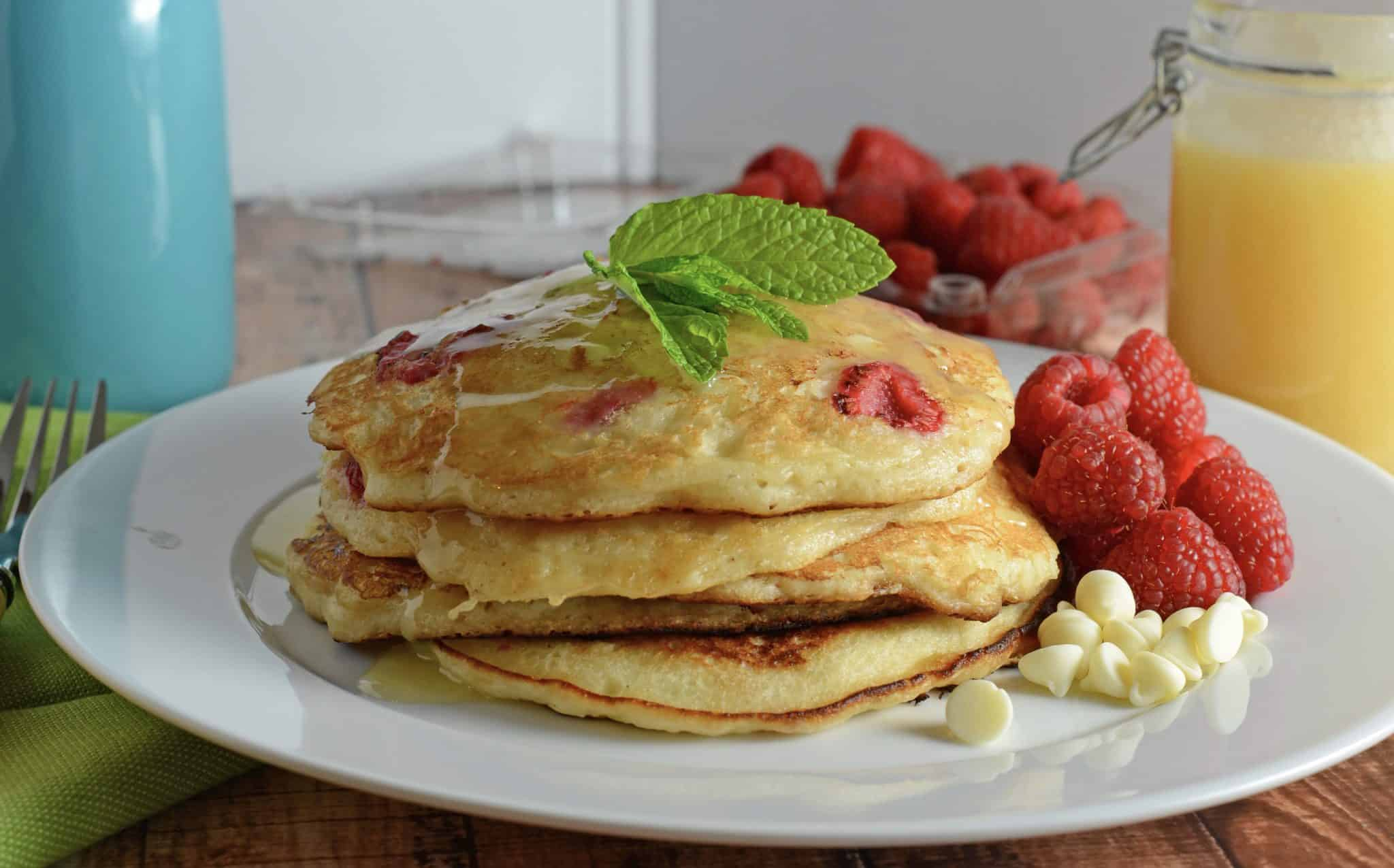 Short stack of white chocolate raspberry pancakes