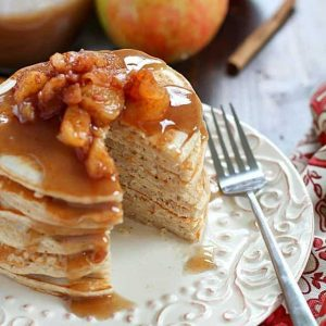 Applesauce pancakes on a white plate