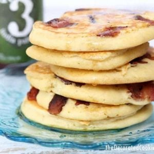 Pancakes with bacon on a blue plate